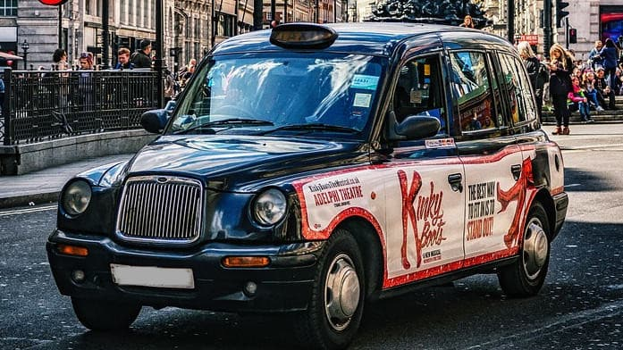 A London Taxi advertising on the side