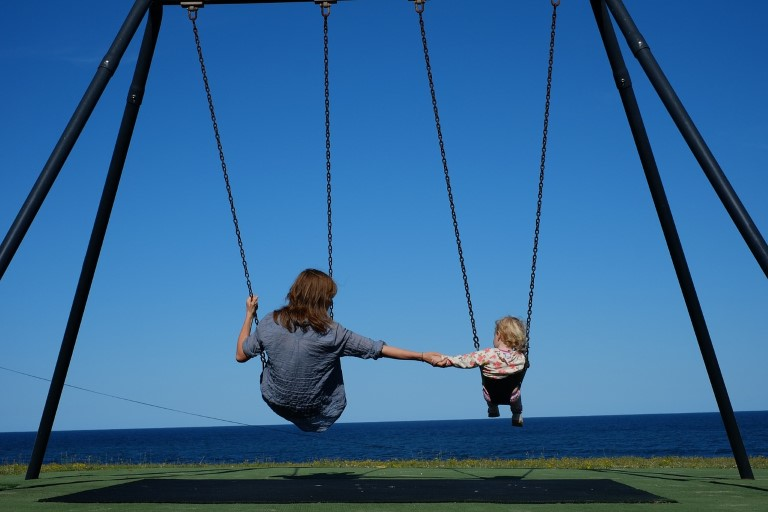 mom and daughter swing on the beach Custom